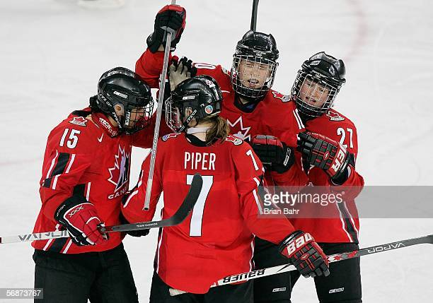 Cherie Piper of Canada is congratulated by teammates Danielle Goyette Gillian Apps and Gina Kingsbury after scoring the team's fifth goal of the game...