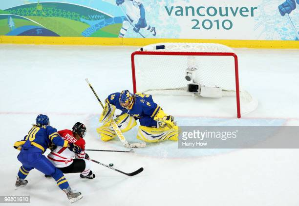 Cherie Piper of Canada scores her team's third goal past goalkeeper Kim Martin of Sweden under pressure from Emilia Andersson of Sweden during the...