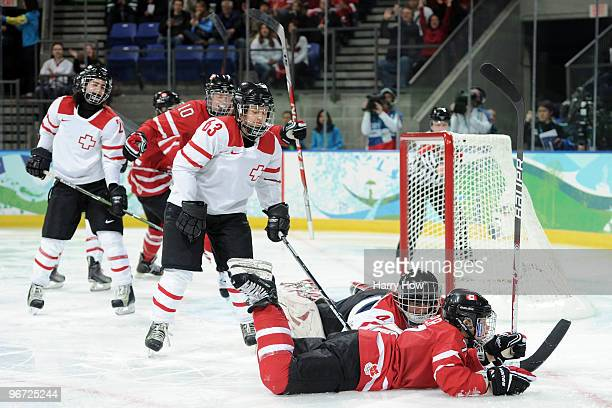 Cherie Piper of Canada scores the third goal during the Women's ice hockey preliminary game between Switzerland and Canada on day 4 of the Vancouver...