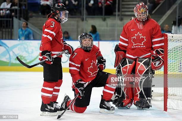 Cherie Piper of Canada smiles with her team mates during the Women's ice hockey preliminary game between Switzerland and Canada on day 4 of the...