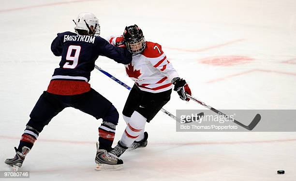 Cherie Piper of Canada with Molly Engstrom of the USA during the ice hockey women's gold medal game between Canada and USA on day 14 of the Vancouver...