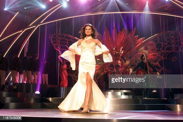 CherieLouise Pisani who is representing Great Britain at the 1999 Miss Universe competition walks across the stage during the the final dress...