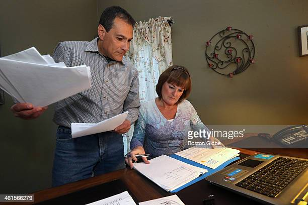 Cherif Kamel looking through documents that show he picked a health plan has the cashed check and receipt yet he still has no information about his...