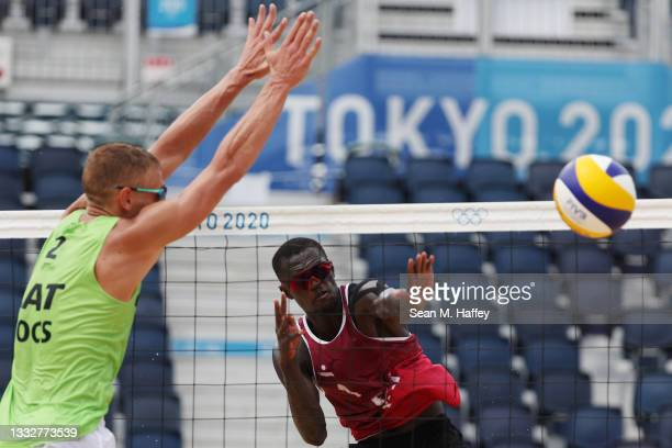 Cherif Younousse of Team Qatar hits the ball against Edgars Tocs of Team Latvia during the Men's Bronze Medal Match on day fifteen of the Tokyo 2020...