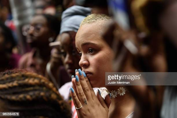 Cherise Green of the Hill District joins more than 200 people gathered for a rally to protest the fatal shooting of an unarmed black teen at the...