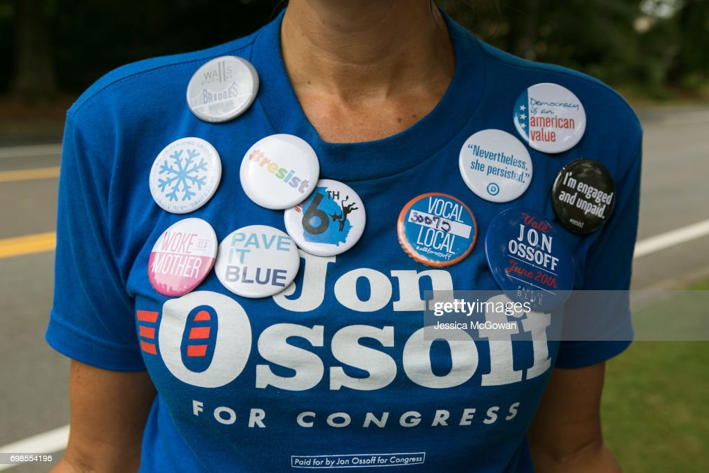 Cherish Burnham of Roswell decorates her shirt with political buttons and shows her support of Democratic candidate Jon Ossoff on June 20, 2017 in Roswell, Georgia. Voters head to the polls to cast their vote in Georgia's 6th Congressional District special election. Republican Karen Handel and Democrat Jon Ossoff are running against each other in a special election to fill the congressional seat vacated by Secretary of Health and Human Services Tom Price.