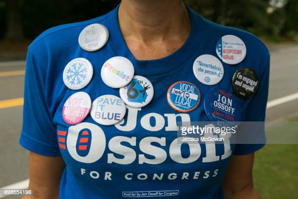 Cherish Burnham of Roswell decorates her shirt with political buttons and shows her support of Democratic candidate Jon Ossoff on June 20 2017 in...