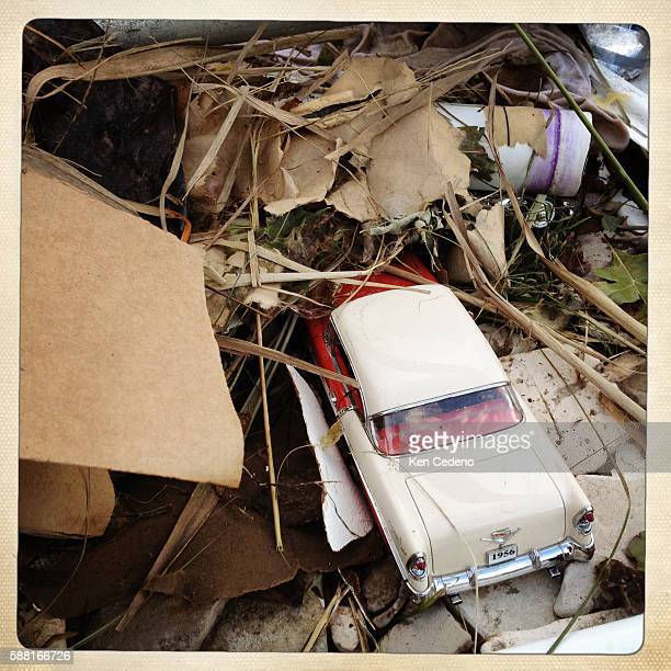 Cherished toys and small model cars are found among the personal belongings whre these homes once were after being severely damaged by Superstorm...