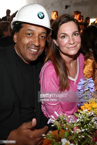 Cherno Jobatey and Alexandra Kamp attend roofing ceremony at BMW new Berlin location at BMW Niederlassung Berlin on May 7 2013 in Berlin Germany