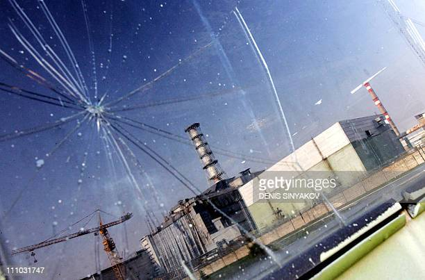 Chernobyl nuclear power plant is reflected in an excavator's window 25 April 2006 Ukraine marks 26 April 2006 the 20th anniversary of the explosions...