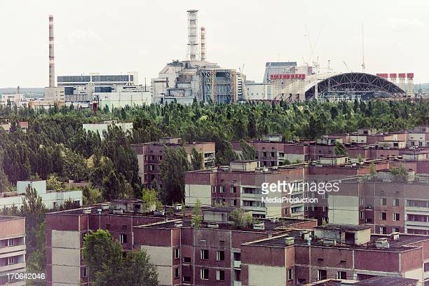 chernobyl nuclear reactor and pripyat ghost town - chernobyl disaster stock pictures, royalty-free photos & images