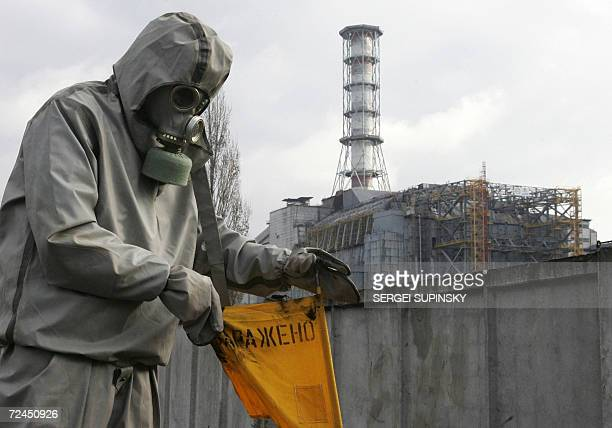 Rescue worker sets flag signalling radioactivity in front of Chernobyl nuclear power plant during a drill organized by Ukraine's Emergency Ministry...