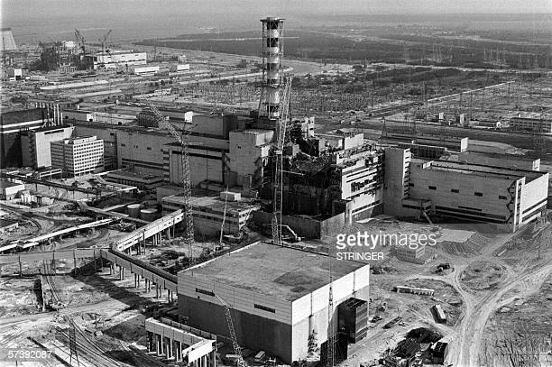 Picture taken from a helicopter in April 1986 shows a general view of the destroyed 4th power block of Chernobyl's nuclear power plant few days after...