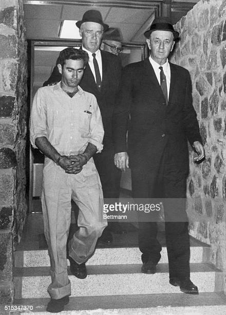 Cherokee County Sheriff Julian Wright and State Law Enforcement Division Agent Earle Collings lead Lee Roy Martin a 28yearold Gaffney SC textile...