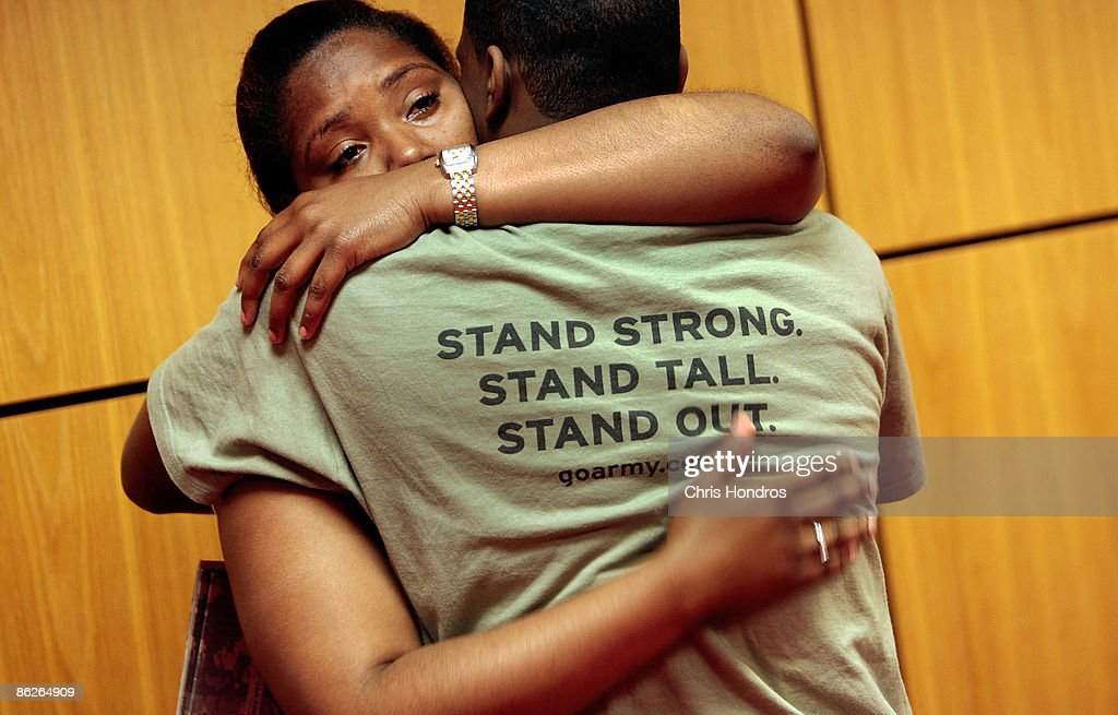Cherokee Hill, 19, (L) of the Bronx, hugs her friend Devernier Smith, also 19, just before he takes the Oath of Enlistment to join the US Army April 28, 2009 at Fort Hamilton in the Brooklyn borough of New York City. Nearly 8000 local recruits for the military's five service branches are processed through Ft. Hamilton's Military Entrance Processing Station every year, getting medical tests, background checks and taking an oath of allegiance before being sent off to camp for basic training.