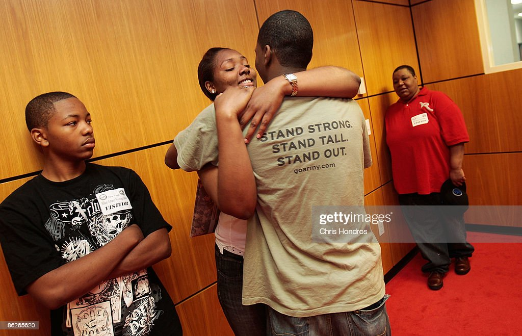 Cherokee Hill, 19, (2nd-L) of the Bronx, hugs her friend Devernier Smith, also 19, while his brother Ronnie Smith (L) and aunt K.C. Abner look on just before he takes the Oath of Enlistment to join the U.S. Army April 28, 2009 at Fort Hamilton in the Brooklyn borough of New York City. Nearly 8000 local recruits for the military's five service branches are processed through Ft. Hamilton's Military Entrance Processing Station every year, getting medical tests, background checks and taking an oath of allegiance before being sent off to camp for basic training.