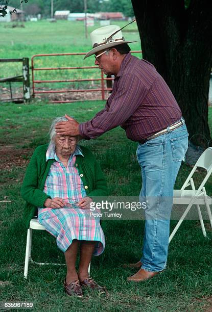 Cherokee medicine man Crosslin Smith attempts to a heal woman.
