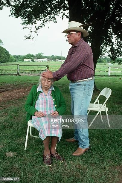 Cherokee medicine man Crosslin Smith attempts to heal woman.