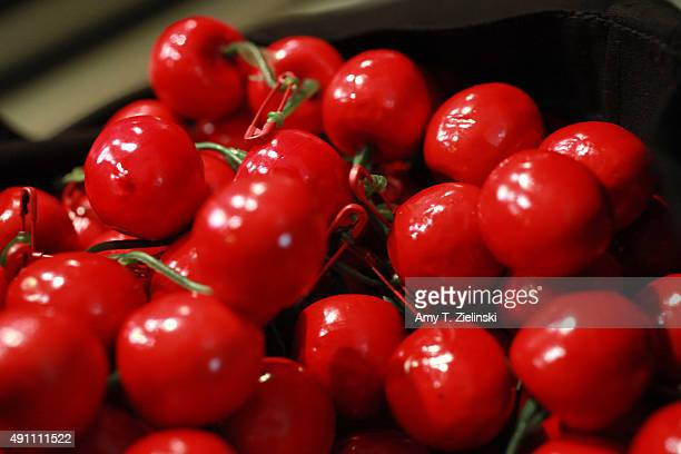 Cherries as used by the character of Audrey Horne in the TV show Twin Peaks are distributed during the sixth annual Twin Peaks UK Festival at Genesis...
