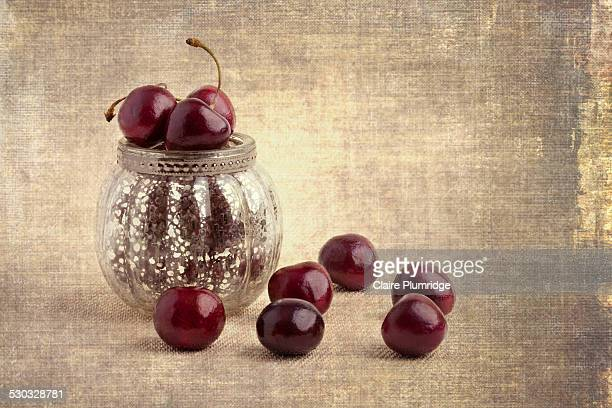 cherries in a bowl - claire plumridge stock pictures, royalty-free photos & images