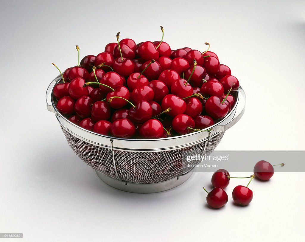 Cherries in colander : Stock Photo