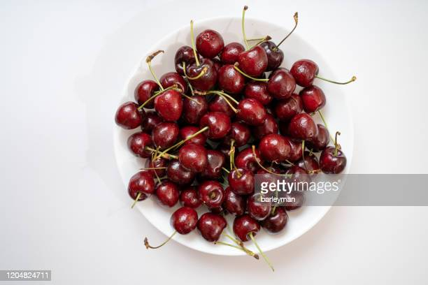 cherries on a solid background - チーク ストックフォトと画像