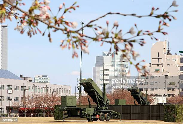 Cherry blosoms bloom in front of Patriot Advanced Capability3 interceptors upon its compeletion of deployment at Ministry of Defense on March 29 2009...