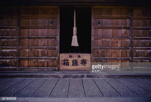 cherry blossom petals on floor of shrine at hirosaki castle - hirosaki castle stock pictures, royalty-free photos & images