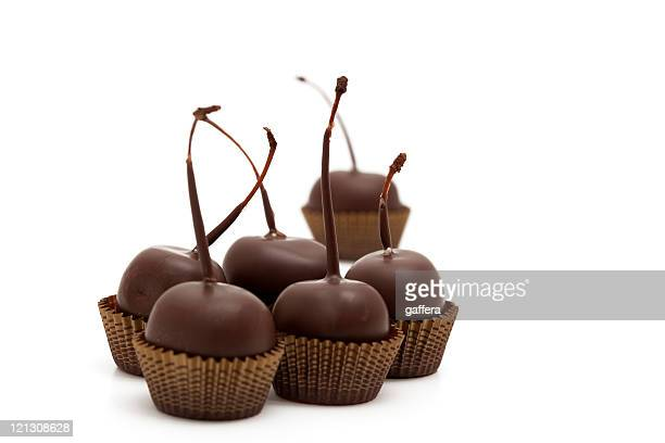 cherry chocolates - chocolate dipped stock pictures, royalty-free photos & images