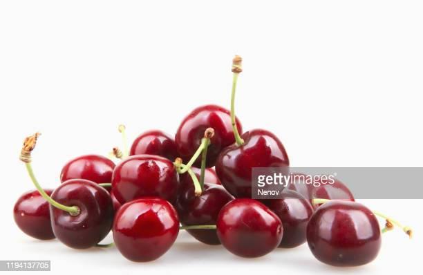 cherry isolated on white background - サワーチェリー ストックフォトと画像