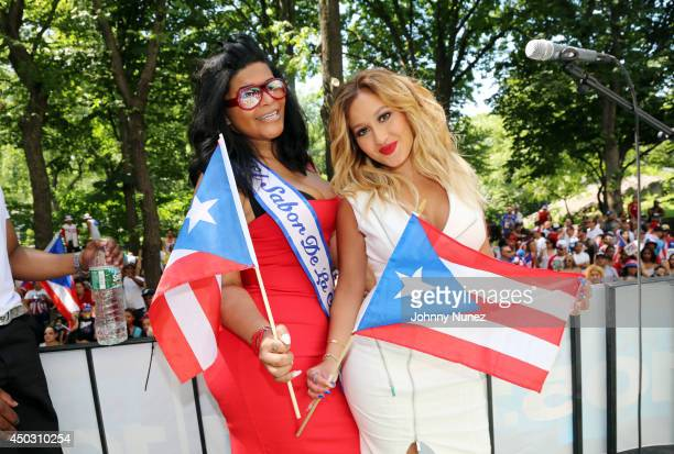 Cherry Martinez and Adrienne Bailon attend the 2014 Puerto Rican Day Parade on June 8 2014 in New York City