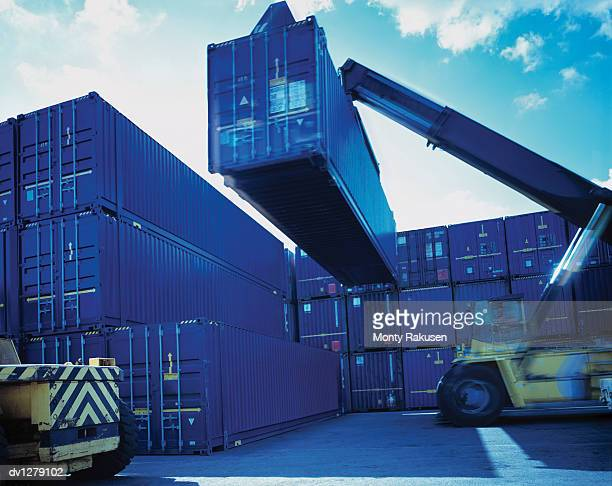 Cherry Picker Lifting Cargo Container for Freight Transportation, Immingham Port, UK