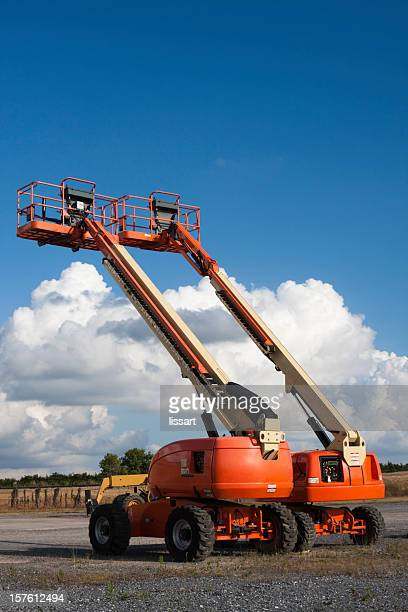 Cherry Picker Lifts with Cloud Background