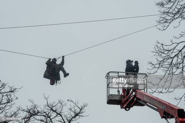 Cherry pickers are used by specialist bailiffs to move in on protestors occupying trees at the protest on January 27, 2021 in London, England. The...
