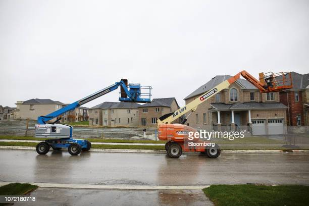 Cherry pickers sit in front of homes under construction in East Gwillimbury Ontario Canada on Friday Nov 2 2018 STCA Canada is scheduled to release...