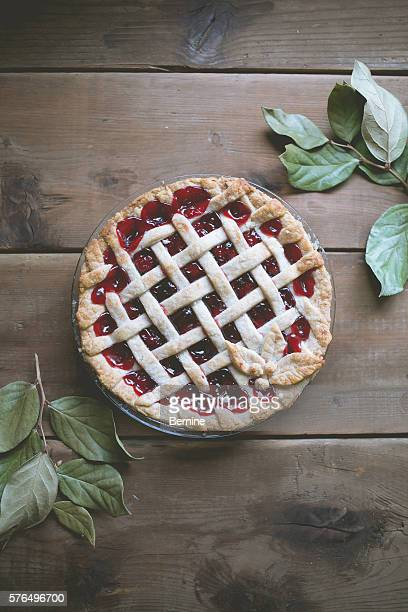 Cherry pie on wooden table top