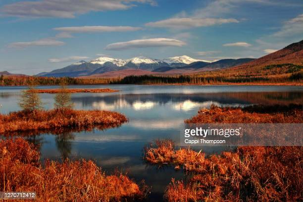 cherry pond with the new hampshire white mountains presdiential range in background. usa - new hampshire stock pictures, royalty-free photos & images