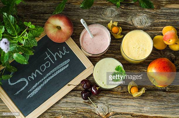 Cherry smoothie, apricot peach smoothie, parsley mint smoothie and fruits