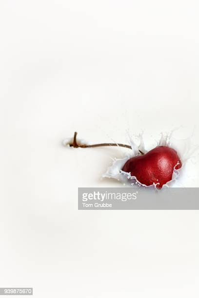 cherry splash - tom grubbe stock pictures, royalty-free photos & images