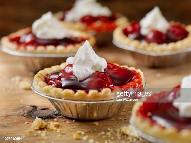 cherry tarts with whip cream - sweet pie stock pictures, royalty-free photos & images