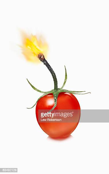 cherry tomato bomb - fuse stock photos and pictures