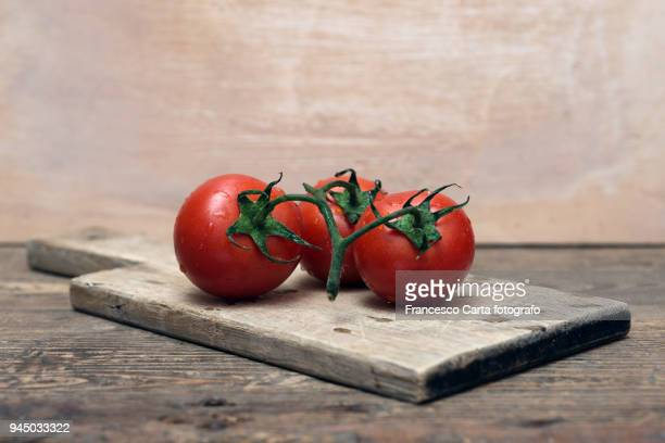cherry tomato - cutting board stock pictures, royalty-free photos & images