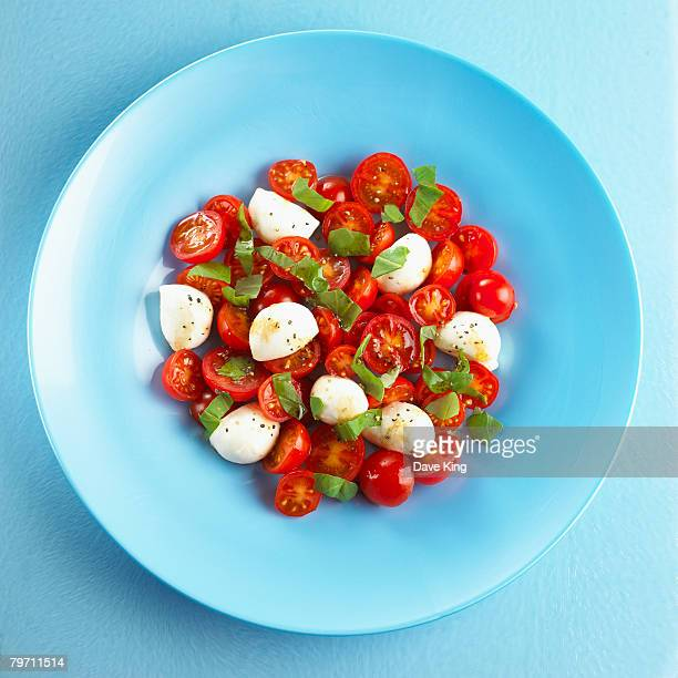 Cherry tomatoes, mozzarella and basil leaves, close up