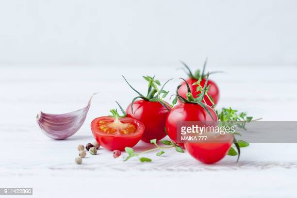 Cherry tomatoes on a white wooden background