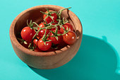cherry tomatoes blue background with hard