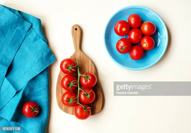 Cherry tomatoes on cutting board and plate