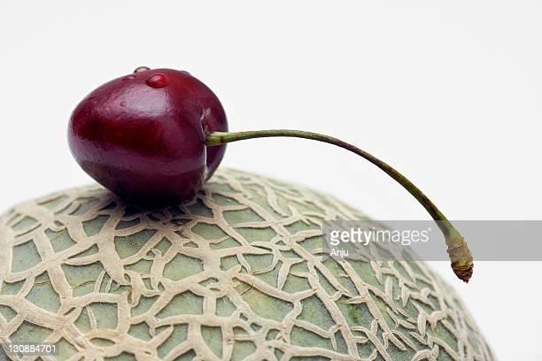 cherry with melon - moschus kürbis stock-fotos und bilder