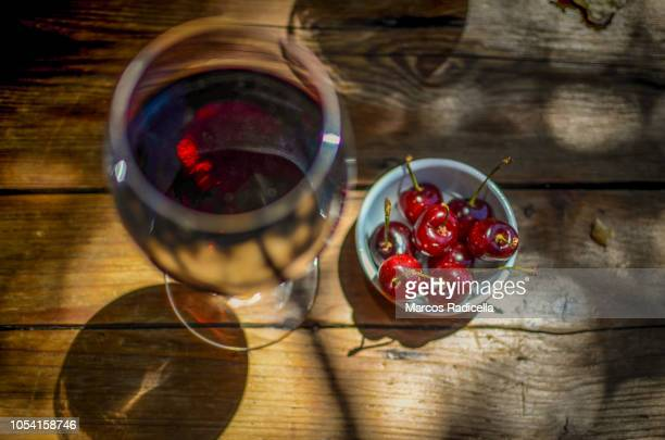 cherry with wine - radicella stock photos and pictures