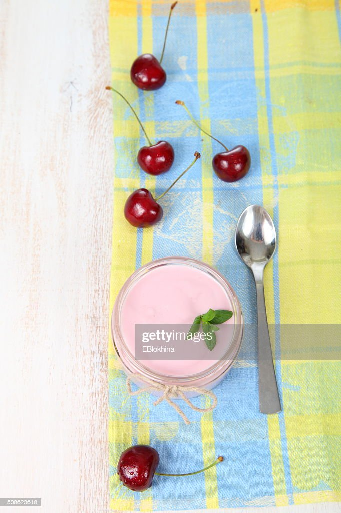 Cherry yogurt and ripe cherry : Stock Photo