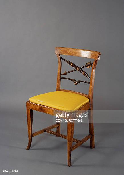Cherrywood chair with decorative carved pattern on the back End of 18th century